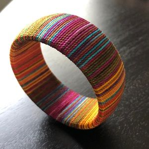 Thick multi string colored bangle bracelet
